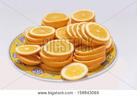 Fresh juicy orange round sliced slices closeup at plate