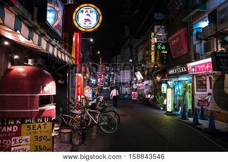 Osaka - July 2016: Night street view in area with gastropubs.