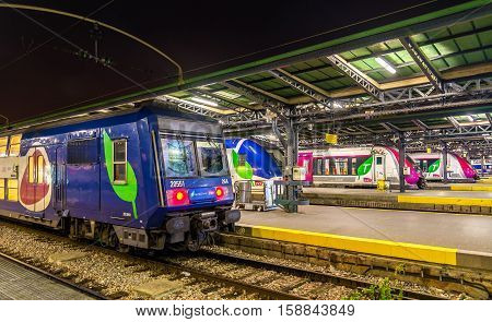 Paris, France - October 9, 2016: Parisian suburban trains Transilien at Paris-Est station. Transilien network transports around 3 million passengers per day