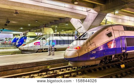 Paris, France - October 9, 2016: High-speed TGV trains at Montparnasse railway station. Paris-Montparnasse station provides connections to Bordeaux, Tours, Rennes and other cities in the west and south-west of France