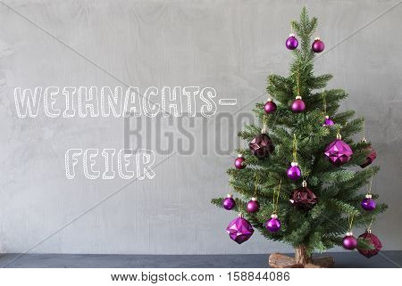 German Text Weihnachtsfeier Means Christmas Party. Christmas Tree With Purple Christmas Tree Balls. Card For Seasons Greetings. Gray Cement Or Concrete Wall For Urban, Modern Industrial Styl.