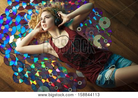 Beautiful Young Woman In Headphones Have Fun And Listen Music