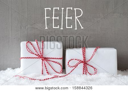 German Text Feier Means Celebration. Two White Christmas Gifts Or Presents On Snow. Cement Wall As Background. Modern And Urban Style.
