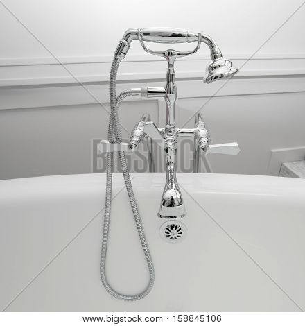 closeup view of shiny chrome bath tub old style vintage retro faucet on grey background