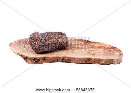 Grass fed juicy corn roast beef on olive wood cutting board isolated on white background
