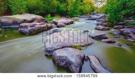 Run of mountain river in forest