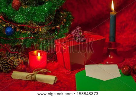 Christmas Tree With Open Envelope, Paper And Burning Candle