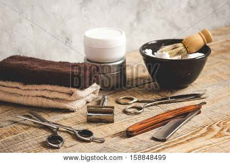 Wooden desktop with tools for shaving close up