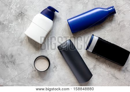 cosmetics for men in bottle on gray background top view.
