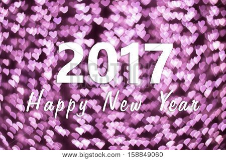 2017 Happy New Year background with little pink heart bokeh