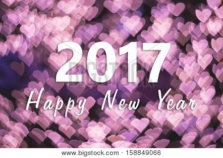 2017 Happy New Year background with pink heart bokeh