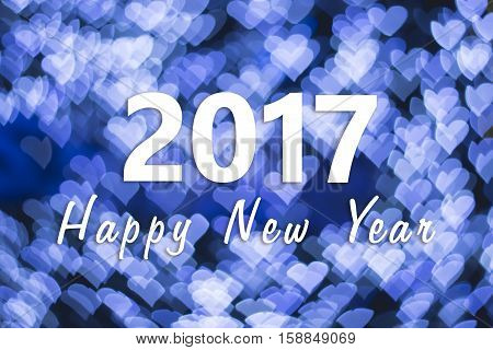 2017 Happy New Year background with blue heart bokeh