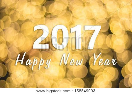 2017 Happy New Year background with golden bokeh