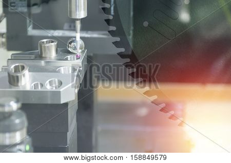 The abstract scene of the CMM Coordinate Measuring Machine while measure the sample work pieces with lighting effect.