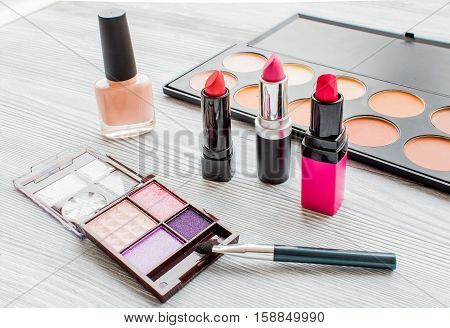 set of colorful decorative cosmetics on wooden background.