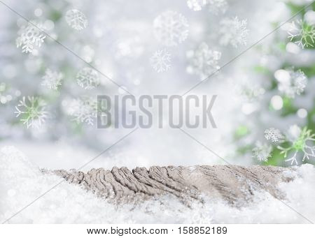 Christmas background snow ice on old wooden snowflakes blurred