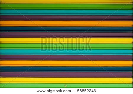 Corrugated paint metal in green, yellow and purple