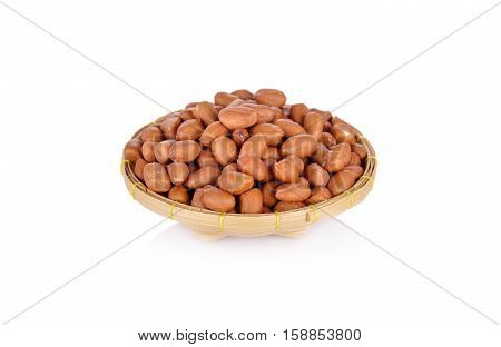 dry peanut in bamboo basket on white background