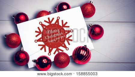 White and red greetings card against wooden background
