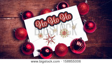 White and red greetings card against digitally generated grey wooden planks