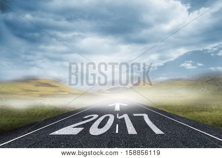 arrows against cloudy landscape background with street