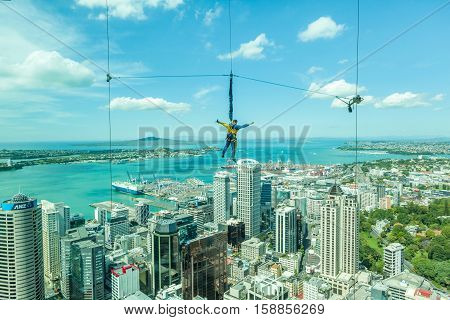 Auckland New Zealand- December 12 2013. Bungee jumping man from Auckland sky tower.