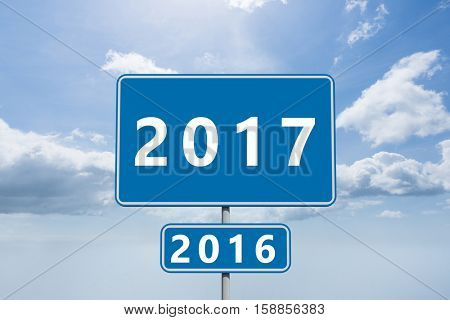 Digital image of new year 2017 against blue sky