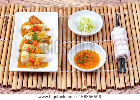 Steamed Stuffing Flour Wrap Pork And Cabbage Topped Yellow Curry .