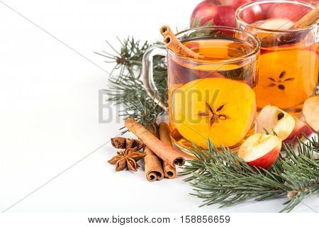 Christmas hot apple cider with cinnamon, anise and orange on a white background