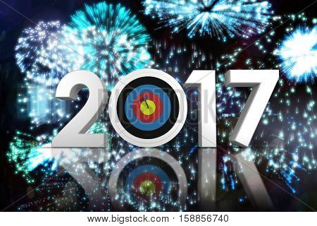Composite image of 3D number with sports target against colourful fireworks exploding on black background
