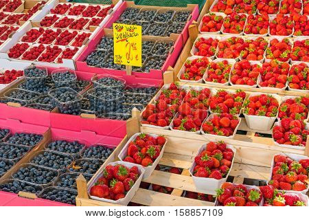 Strawberries, blueberries and raspberries for sale at a market