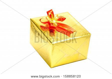 A gold gift box with red ribbon bow on white background Merry Christmas greeting.