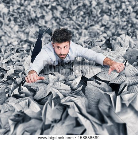 Businessman trying to escape from a pile of paperwork poster