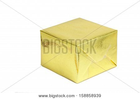 A shiny gold gift box on white background season greeting concept.