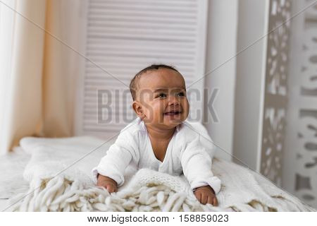 Adorable little african american baby boy laughing - Black people.