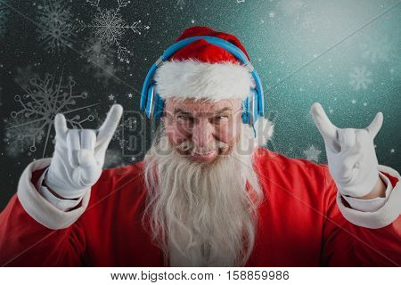 Portrait of Santa Claus gesturing against snowflake pattern