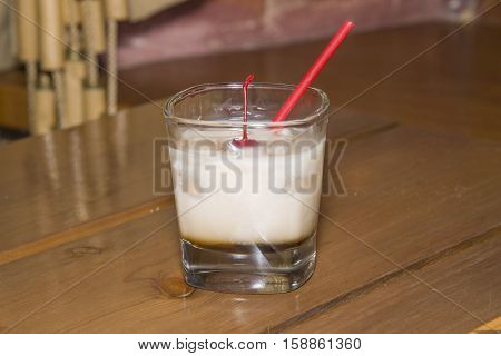 Dairy Cocktail In A Glass With A Cherry.
