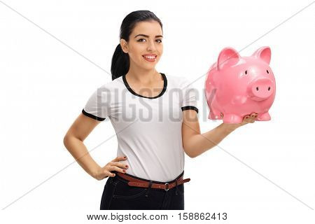 Happy young woman holding a piggybank isolated on white background