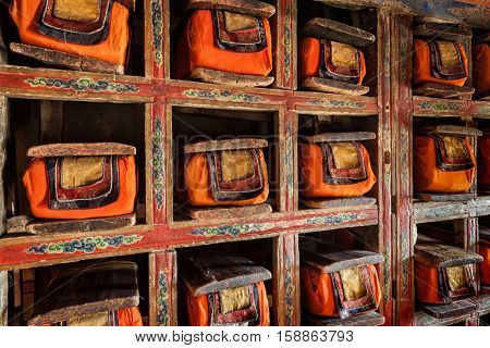 Folios of old manuscripts in library of Thiksey Gompa (Tibetan Buddhist Monastery). Ladakh, India poster