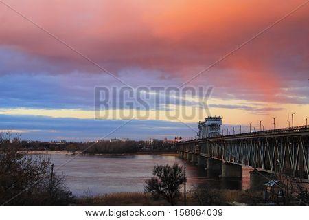 Bridge across river Dnieper at sunset in Kremenchug, Ukraine