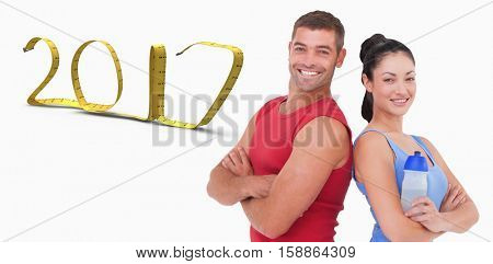 Fit man and woman smiling at camera together against white background with vignette 3D new year
