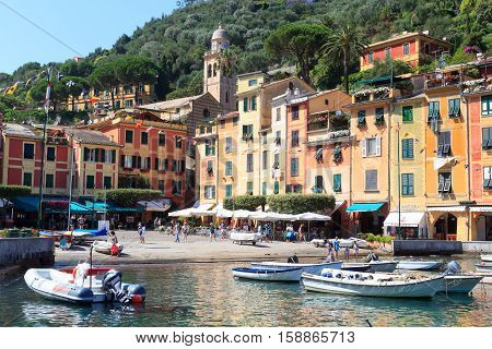 Portofino, Italy - June 28, 2016: Portofino port with colorful houses, boats and Mediterranean Sea. Portofino is an Italian fishing village and vacation resort famous for its picturesque harbour.