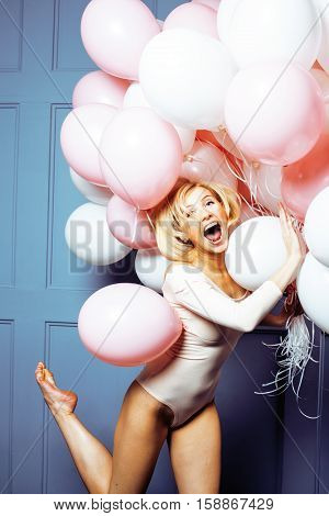 young happy blonde real woman with baloons smiling close up, lifestyle real people concept