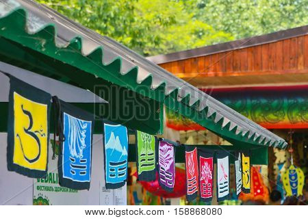 bright colored flags with the symbols of the Book of Changes in the festival