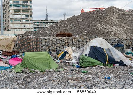 Migrant tent in Genoa beach Italy close up