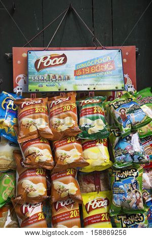 Hanoi, Vietnam - Nov 26, 2016: Close up of many snack packages of many local Vietnamese brands hanging for sale at a street of Hanoi.
