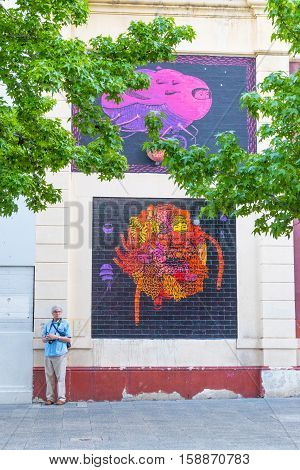 PERTH, AUSTRALIA - NOVEMBER 15, 2015: An unidentified photographer looking for subjects to photograph in the centre of Perth capital of Western Australia.