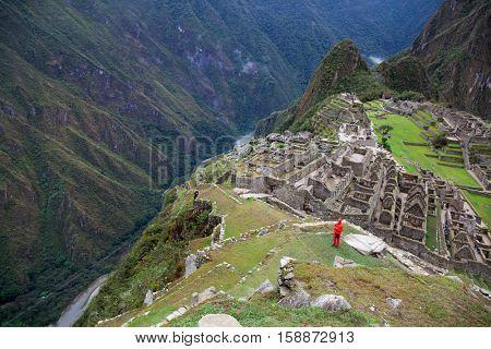 MACHU PICCHU NOVEMBER 11: Tourists walk in Machu Picchu site on November 11 2015 in Machu Picchu.