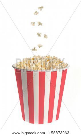 Popcorn falling into a classic striped bucket isolated on white background