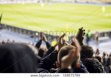 Fans At The Stadium Support Their Team